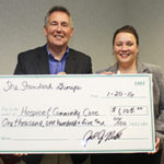 Joel North from The Standard Group presents a check for $1,105 to Amy Lewis, Director of Annual Giving.